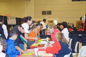"Parents register their children for school at the Port Arthur Independent School District's One Stop Registration event in the Robert A. ""Bob"" Bowers Civic Center in Port Arthur Tuesday."