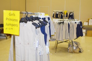 "Academy Uniforms offers racks and tables of school uniforms, as well as portable changing booths, at the Port Arthur Independent School District's One Stop Registration event in the Robert A. ""Bob"" Bowers Civic Center Tuesday."