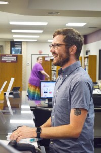 "Skyler Williams, 32, of Groves checks in a patron's books Monday at the Effie & Wilton Hebert Public Library in Port Neches. Williams, a spring 2015 Lamar University graduate who has called the library's front desk ""home base"" for the last 16 years, is leaving Thursday to join his partner, Ray Palko, in San Francisco, Calif. Williams said he and Palko will marry at San Francisco City Hall on June 30."