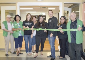Trey Thompson, third from right, along with staff and members of the Groves Chamber of Commerce and Tourist Center, celebrate the ribbon cutting for Thompson's business, Everlasting Images Photography and Video, 4300 Lincoln Ave., Suite 4 in Groves, on Thursday.