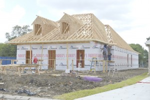 A home under construction in the new Heritage Point Addition in Groves.