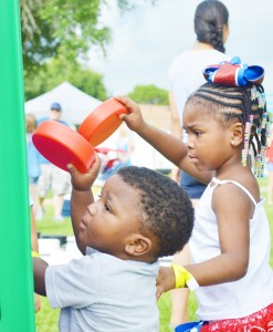 Port Arthur natives Deezy Givens, 2, left and his sister D'niya Givens, 4, play an oversized game of Connect 4 during the Fireworks Extravaganza Fourth of July celebration at Doornbos Heritage Park in Nederland Saturday.