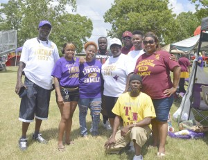 A group of friends who are graduates from Lincoln, Thomas Jefferson and Memorial high schools take a break for a photo during the Port Arthur Alumni Picnic on Pleasure Island on Saturday.
