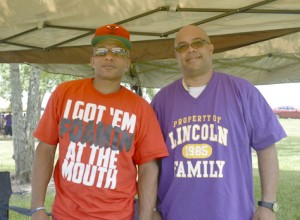 Warren Jones, left, and Lincoln High School Class of 1984 graduate Reao Keller at the Port Arthur Alumni Picnic on Pleasure Island on Saturday.