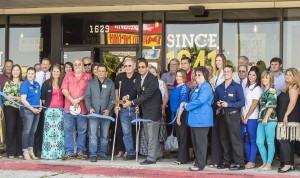 Andy Maredia, Dickey's Barbecue Pit owner, center, cut two ceremonial ribbons Thursday for the Nederland and Port Arthur Chambers of Commerce during the grand opening ceremony for Dickey's new location off Hwy 69 in Nederland, across from Central Mall in Port Arthur.