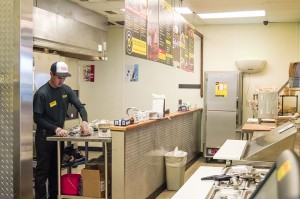 A Dickey's Barbecue Pit employee wraps freshly smoked brisket before the restaurant opens for business Thursday morning in Nederland.