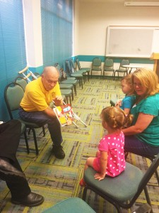 """Nederland Mayor Richard """"Dick"""" Nugent reads books about fire fighters and their service trucks during """"Story Time with the City Officials,"""" a special summer series, in the Marion & Ed Hughes Public Library July 23."""