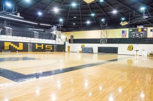 H.B. Neild & Sons gave the Nederland High School Dog Dome a face lift this summer with energy efficiency upgrades and new paint. The company is still renovating the old stage area, extending the gym floor to where the stage used to stand and painting an extensive mural on the new wall.