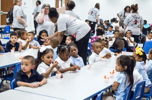 Wheatley School of Early Childhood students end their first day of the new school year munching carrots during snack time in the cafeteria Monday in Port Arthur.