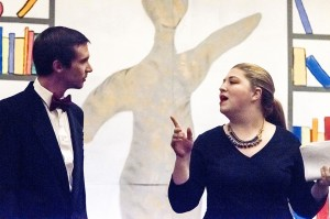 """Alex Savoie, playing Baxter Mallenstock, left, and Haleigh Courts, playing Mimi Sheraton, rehearse a scene from the musical """"Bullets for Broadway"""" during a dress rehearsal at the Port Arthur Little Theatre Wednesday."""