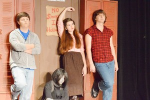 """Ross Lefort, left, Emelie Sullivan, Resa Pletcher and Jason Blevins practice their roles as an athlete, a basket case, a princess and a criminal during a dress rehearsal for the Port Arthur Little Theatre Junior Board's production of """"The Breakfast Club"""" at the Little Theatre Wednesday night."""
