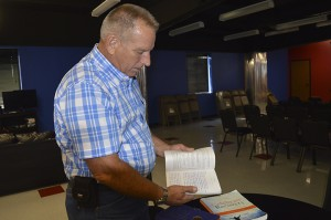 John Ramsey scrolls through his copy of Celebrate Recovery Inside.  Mary Meaux/The News