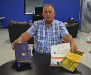 John Ramsey shows some of the tools that helped him in his sobriety. God, he said, is what helped him in recovery.  Mary Meaux/The News