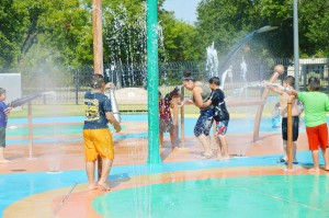 Families beat the 112-degree heat index Monday afternoon by cooling off at the Port Neches Spray Park. Parents stayed in the action, letting their casual clothes get soaked along with their children's bathing suits.