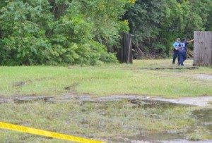 Crime scene tape marks off an area adjacent to and behind Royal Furniture, 4221 Gulfway Drive, on Tuesday where a homicide victim was located.   Mary Meaux/The News