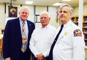 Central Middle School Principal Charlie Jehlen, left, poses with Nederland Police Chief Darrell Bush and Nederland Fire Chief Gary Collins during the annual First Responders Day Breakfast in honor of 9/11 Friday morning in the Central Middle School library.