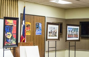 "Artist Ted Ellis added elements from library posters to his signature ""Colored Man"" painting to help promote literature and ""the language of art"" during the Port Arthur Public Library's ""A Day of Art Appreciation"" Saturday."