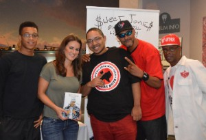 "Corey Butler, left, author Julia Beverly, Chad Butler Jr., Daniel ""DJ Bird"" Grogan, and Millard ""Pops"" Roher pose for a photo at the Museum of the Gulf Coast during the book signing for Beverly's book ""Sweet Jones: Pimp C's Trill Life Story."" Mary Meaux/The News"