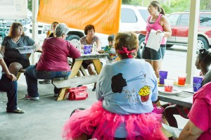 Kathy Williams, Curves of Nederland team captain, center, listens while Kara Baker Booth, Relay for Life of Mid- and South Jefferson County event co-lead, explains the proposed setup along Boston Avenue during the 2016 Retro Relay Kickoff meeting Tuesday night at the Nederland Heritage Festival Pavilion.