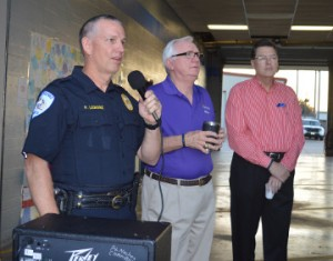Port Neches Police Chief Paul Lemoine, left, greets a crowd of citizens prior to prayer along with Mayor Glenn Johnson and The Rev. David Mahfouz of First Baptist Church Port Neches   during See You At the Station in Port Neches on Wednesday. Mary Meaux/The News