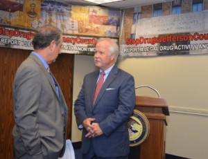 Jefferson County Sheriff Mitch Woods, left, speaks with U.S. Attorney Malcolm Bales before a press conference announcing the launch of several websites to assist communities with drug relates community concerns. Mary Meaux/The News