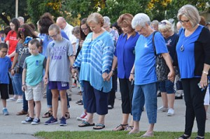 Crowds hold hands and pray during See You At the Station in Port Neches on Wednesday. Mary Meaux/The News