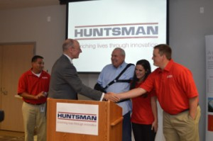 Lamar University President Kenneth Evans, second from left, shakes hands with Huntsman employee Josh Matthews as Brian Hurtado, left, Huntsman Corporation Founder Jon Huntsman and Bria Thibodeaux, look on at the plant Tuesday.  Mary Meaux/The News