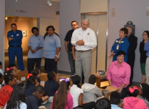 Past president of the Port Arthur Rotary Club Bill Wortham, center, speaks with third grade students from Adams Elementary School about their brand new dictionaries courtesy of the Port Arthur Rotary Club and Motiva Enterprises at the Museum of the Gulf Coast on Wednesday. Mary Meaux/The News