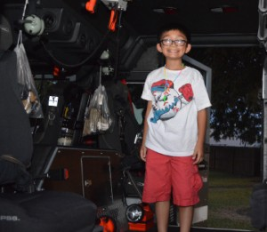 Ryan Pham, 9, of Groves, gets a tour inside of a fire engine during Groves Fire Department's Open House on Wednesday. Mary Meaux/The News