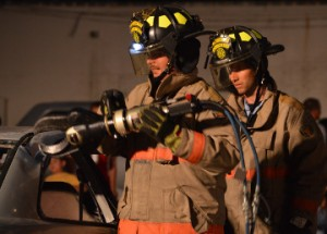 Groves firefighters use the Jaws of Life in a extrication demonstration during open house at Groves Fire Department on Wednesday. Mary Meaux/The News