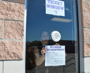 Amanda Delcambre, secretary at Port Neches-Groves High School, posts information about PNG VS Nederland ticket sales at the ticket office on Wednesday. Mary Meaux/The News