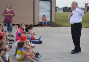 Port Neches Fire Chief Steve Curran speaks to families prior to a residential sprinkler and smoke alarm live burn demonstration during the department's open house on Thursday. Mary Meaux/The News