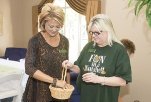 Tonya Petix, president of the Groves Chamber of Commerce and Tourist Center, left, picks a ticket for a door prize along with Debbie Snell, administrative assistant with the chamber, during a kick-off event for the Groves Pecan Festival at Magnolia Manor on Wednesday. Roger Cowles/The News