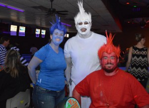 DNJ's Sno Biz employees representing their flavors; Diana Neel, left, as blue raspberry, Eric Kyles as ice and James Neel as cherry during the Fourth Annual Cosmic Bowling Tournament at Max Bowl on Tuesday. The event was hosted by the Greater Port Arthur Chamber of Commerce Ambassadors. Mary Meaux/The News
