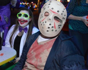 Tiffany Fountain, left, and Wesley Seelke get into the Halloween spirit during the Fourth Annual Cosmic Bowling Tournament at Max Bowl on Tuesday. Mary Meaux/The News