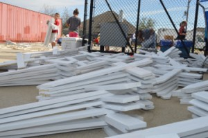 Stacks of painted crosses to be distributed outside Summer's Abbey Flooring in Port Neches on Tuesday. Mary Meaux/The News