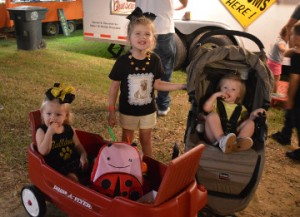 Spencer Delage, left, Peyton Delage and Aubree Bell enjoy the Groves Pecan Festival on Friday. Mary Meaux/The News