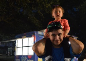 Chase Smith holds Sutton Smith on his shoulders during the Groves Pecan Festival on Friday. Mary Meaux/The News