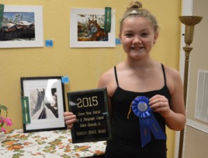 Dezarae Thibodeaux, 11, earned first place youth photo and the Robert Pastorella Sr. Memorial Award for her entry in the Groves Pecan Festival Photo/Art Contest. Mary Meaux/The News