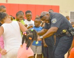 Port Arthur Police Officer Rickey Antoine, right, shows off his dance moves alongside a group of children during the City of Port Arthur Health DepartmentÕs 3rd Annual Bullying Stops Here Rally at the Port Arthur Recreation Center on Wednesday.