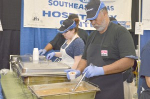 "Michael Bowser, with the Hospitality CenterÕs booth, fills a sample cup with gumbo at the Rotary Club of Port ArthurÕs Annual ""Taste of Gumbo, Etc."" on Saturday at the Robert A. ""Bob""Bowers Civic Center."