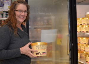 Kerrie Hilton was happy to see Blue Bell ice cream back in area stores. Hilton picked up some Blue Bell at Bruce's Market Basket in Groves on Monday. Mary Meaux/The News