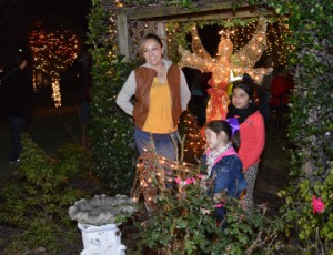 Sandra Rios, left, poses with nieces Giselle Esquivel, 6, and Marlene Guandique, 4, during Christmas events at Celebration Park in Groves on Friday. Mary Meaux/The News