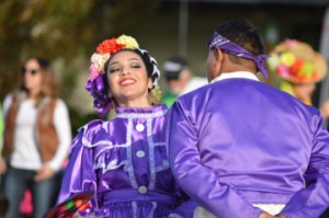 Members of the Mexican Heritage Folkloric Dancers perform during Christmas on the Avenue in Nederland on Saturday. Mary Meaux/The News