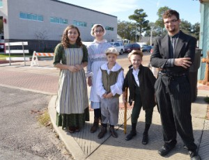 Port Arthur Little Theater cast members from the current production of A Christmas Carol walk the streets of Boston Avenue in Nederland during Christmas on the Avenue on Saturday. Mary Meaux/The News