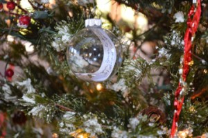 A clear Christmas bulb features a handwritten message for a deceased loved one on the memorial tree at Oak Bluff Memorial Park in Port Neches. Mary Meaux/The News