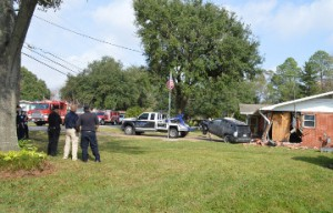 A crashed vehicle is pulled from a home in the 2800 block of Eighth Street in Port Neches shortly before noon Wednesday. Mary Meaux/The News