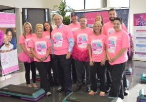 Philpott Motors General Manager Bob Thewman, center, and employees don pink as they Step Up to Cancer by collectively taking 5,405 steps reflective of their contribution to the Gift of Life on Tuesday. Mary Meaux/The News