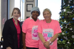 Gift of Life Program Services Manager Christina Morris, left, poses for a photo with breast cancer survivors Ernestine Anderson of Sour Lake, and Lori Odom of Vidor at Philpott Motors in Nederland on Tuesday. Mary Meaux/The News