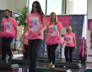 Philpott Motors employee Deanna Miller, second from left, steps up to cancer on Tuesday. Mary Meaux/The News
